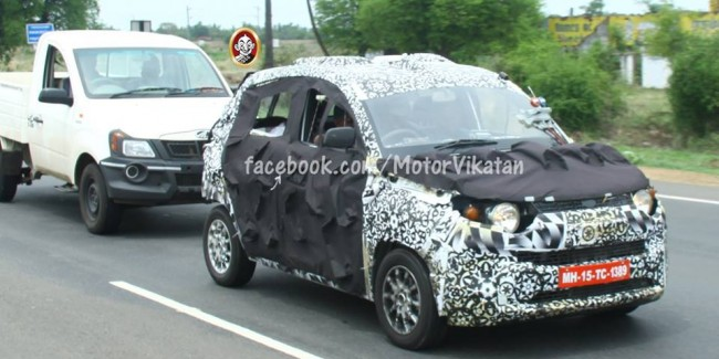 Spy shot of Mahindra S101 towing a pickup truck during test.
