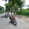 Mr. Arora and his friend on their beloved royal enfield bike in way to Fatehpur Sikri
