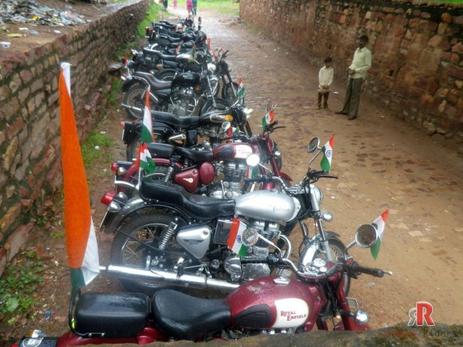 One of the lot of Royal Enfield bikes in parking while riders are inside the monument.
