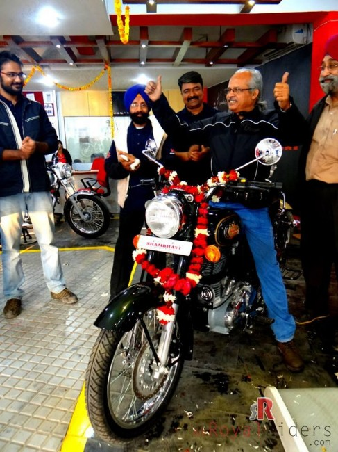 Mr. S.P. Singh and his new Royal Enfield Bullet 500, the moment of joy after a long waiting period to get bike delivered.