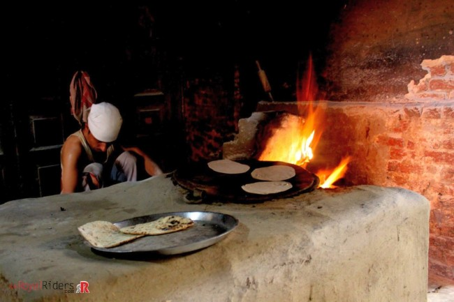 Traditional Chulha (Indian Stove of Wood Fire) used for preparing chapati at Prem Pavitra Bhojanalay, Alwar.