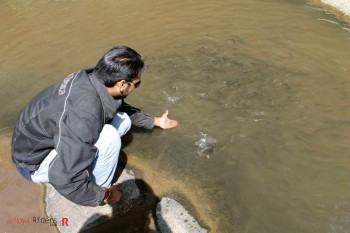 Sankalp Playing with fish at Sariska