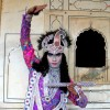 An actor depicting Lord Krishna at Deeg Braj Holi Festival