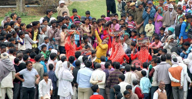 Artist performing traditional dance at Deeg Holi Festival