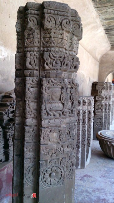 A carved pillar inside the establishment, probably from ruin of temple.