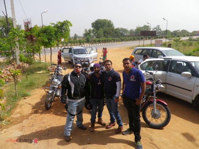 Posing at an halt due to breakdown in one of the Rider's bike.