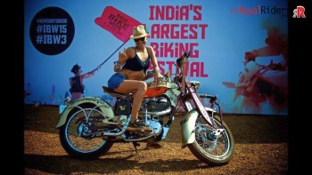 Model at IBW posing on Royal Enfield - Destiny Angel