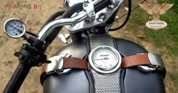 The retro inspired leather strap with speedometer on tank.