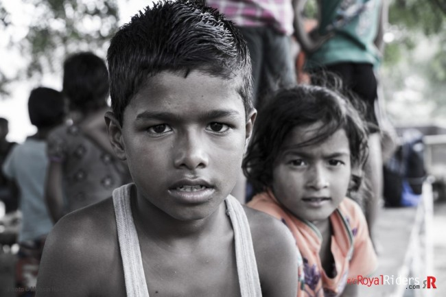 Two kids from Nareshwar Village. Probably they were staring at my fingers as shot them in manual mode. Photo by : Mohsin Hasan