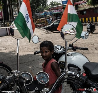 A kid in front of Royal Enfield