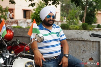 Devender Singh Wilkhoo bosing on his white Royal Enfield Classic.