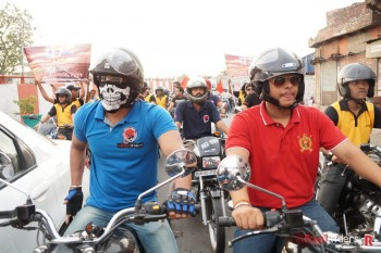 Riders waiting at Traffic Signal with their Royal Enfields.