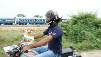 Sankalp Zooming beside a train.